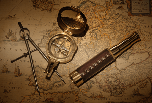 Telescope & compass on a nautical map